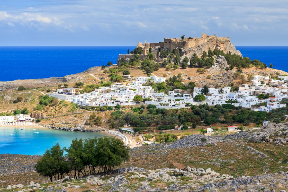 'View from the road down to the popular town of Lindos on the Island of Rhodes Greece' - Rodos